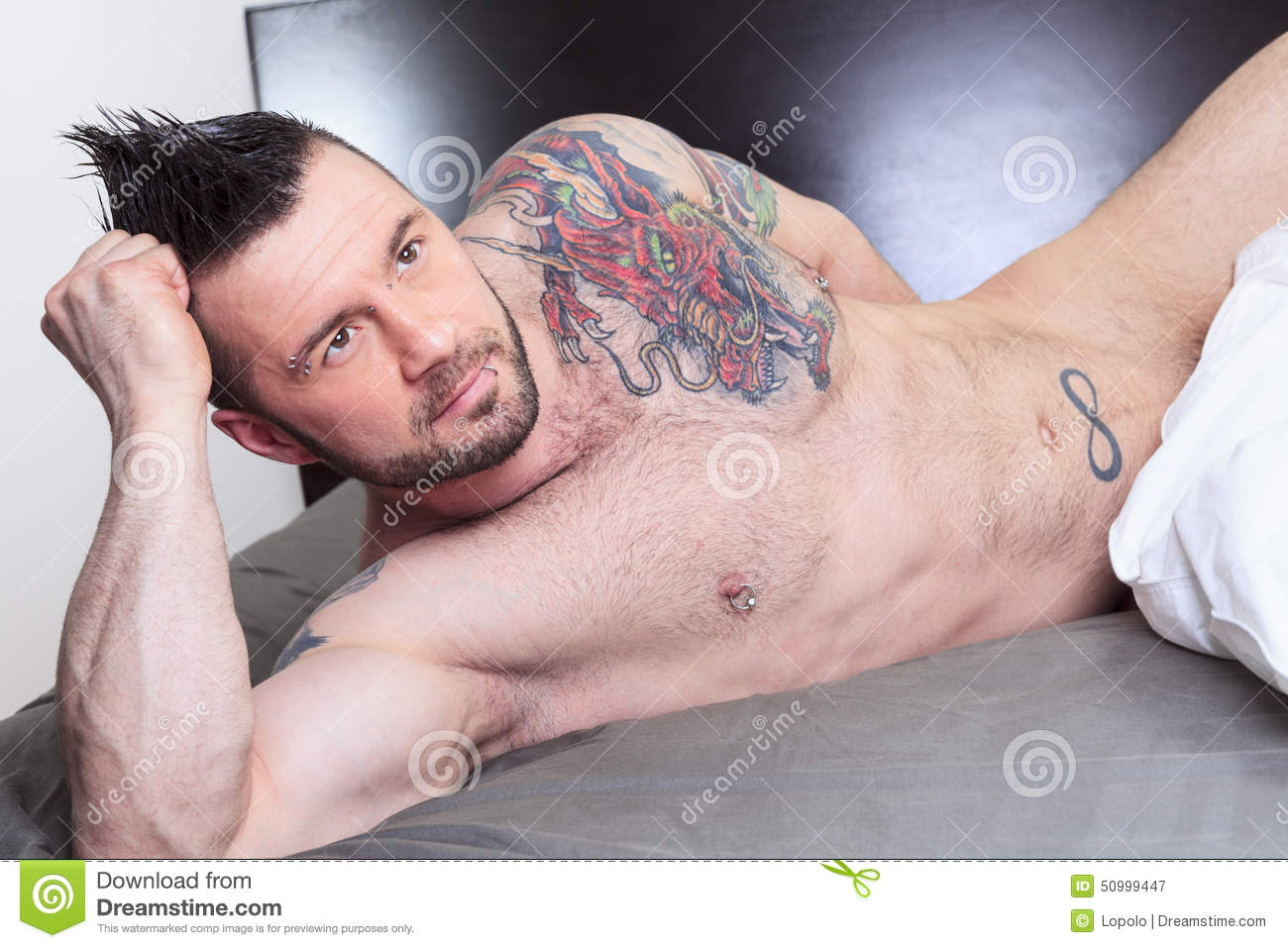 Naked man and sexy with tattoos