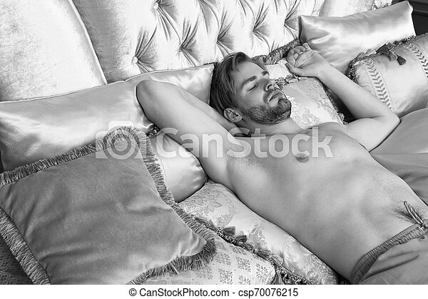 Man sleeping naked on the couch